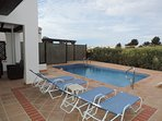 LARGE POOL WITH DECK CHAIRS AND PAGODA PLUS BUILT IN BBQ AND SEATING AREA. FRONTLINE GOLF VIEW