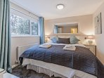 The second bedroom is decorated in chic greys with a super king size bed that can also be a twin.