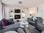 Large and spacious open plan lounge with wall-mounted flat screen TV and Netflix.