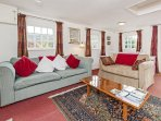 Large open plan living area with comfy sofas and throws at Tucking Mill View. Great views too!
