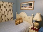 Queen bed with white wood headboard