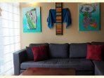 Living room with custom designed paintings by a local artist. Patio to the side.