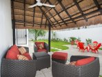 North palapa patio has comfy sofa and chairs plus table and chairs on the courtyard