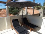 Sun loungers with parasol