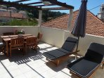 Terrace with sun lounges and dining table