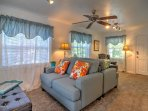 The loveseat couches in the living room face opposite directions, ensuring everyone has the opportunity to admire the...