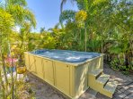 Soak in the shared hot tub for a relaxing end to each day.