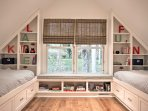 The lofted area has four twin beds and is the perfect set up for kids, with games, puzzles, and books to keep them...