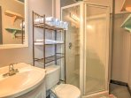 Get ready for your day at the beach in this full bathroom with walk-in shower.