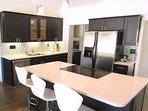 Kitchen & Bar features stainless appliances, large pantry & quartz counters!