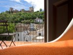 The bedroom has views of the Alhambra.