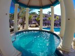8 person jacuzzi overlooking the back pool..