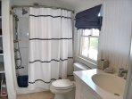 First floor bathroom with bath tub/shower