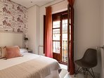 Bedroom No. 2 with a double bed. The window looks out onto Rodo street.