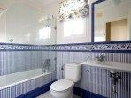 Bathroom No. 2. The bathtub has an overhead shower.