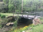 Our bridge crosses over the bold creek, driveway leads up to our COZY cottage.