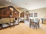 Featuring 2 twin-over-twin log cabin style bunk beds, this is a kid's paradise.