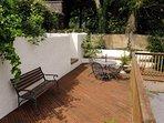 Small patio area to enjoy alfresco dining.