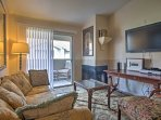 Get cozy and warm up next to the wood-burning fireplace in the warm and inviting living room.