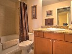 The bathroom is equipped with a bathtub shower, perfect for something quick and easy or lengthy and relaxing.