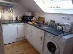 Well equipped modern kitchen with washing machine