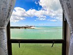 Wake up to a view of Sand Key Beach from the guest room.