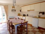 The farmhouse kitchen which sits 6. Dishwasher, washing machine, gas oven, fridge and freezer