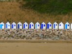 The beach huts on Carteret beach, a local favourite.