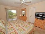 Master bedroom showing flatscreen TV