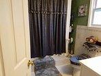 beautiful bathroom with shower/tub
