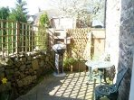 The patio is quite a suntrap  & good for a barbecue.