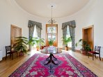 Grand entrance Hall with period furnishings leads to the sweeping Victorian staircase