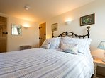 Bedroom 1 with very comfortable king-size double bed, luxury bedding and ensuite shower room