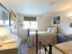 Bedroom 2 with two very comfortable single beds, luxury bedding and ensuite bathroom
