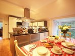 Enjoy the company of your family or friends while preparing meals. Views to the wooodlands and lawns