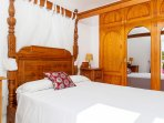 Master bedroom with double bed and private terrace on the second floor