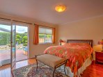 After a dip in the hot tub, retreat to this bedroom with queen bed.