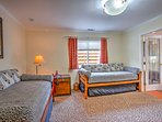This room features 2 twin beds with twin trundles, perfect for kids.