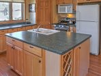 Whip up your favorite recipes in the fully equipped kitchen, which is open to the dining and living area.