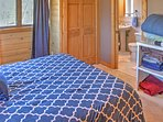 This bedroom features a queen bed and ensuite bathroom.