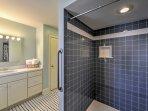 Freshen up in the pristine bathroom.