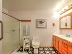 Get ready for bed in this en suite bathroom with walk-in shower.