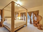 Climb into this spacious king-sized bed with gorgeous 4-poster canopy.