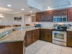 Fully furnished kitchen with granite counter tops with plenty of counter space and SS appliances.