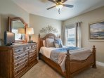 Queen bed with dresser, TV and DVD player.