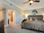 Master bedroom with king size bed, dresser, 2 night stands, TV and DVD player.