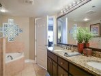 Master bath with double sink and granite vanity, Jacuzzi tub and walk in shower.