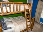 Bedroom #2, upstairs, Twin on top, Double on the bottom.  Made from AK black spruce trees.