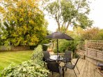 The kitchen opens on to a wooden deck, long gravelled garden with magnificent trees. Table & chairs.