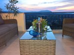 Relax in comfort on the veranda and watch the sun go down.